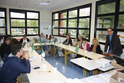 Members of the MobileBE team working around an u-shaped table in one of the classrooms in Cherbourg, France